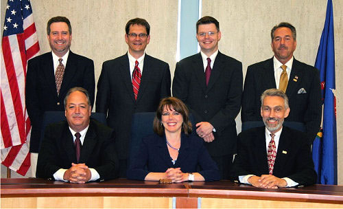 Pictured: Robin Eschliman at front row center with members of the Lincoln City Council in 2009.